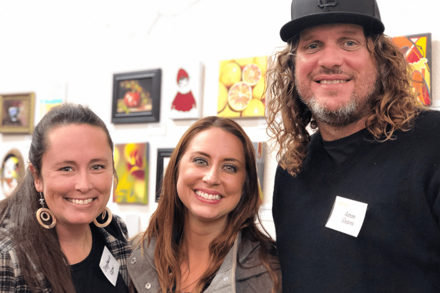 Artist members pose for photo at art gallery in Hollister, California