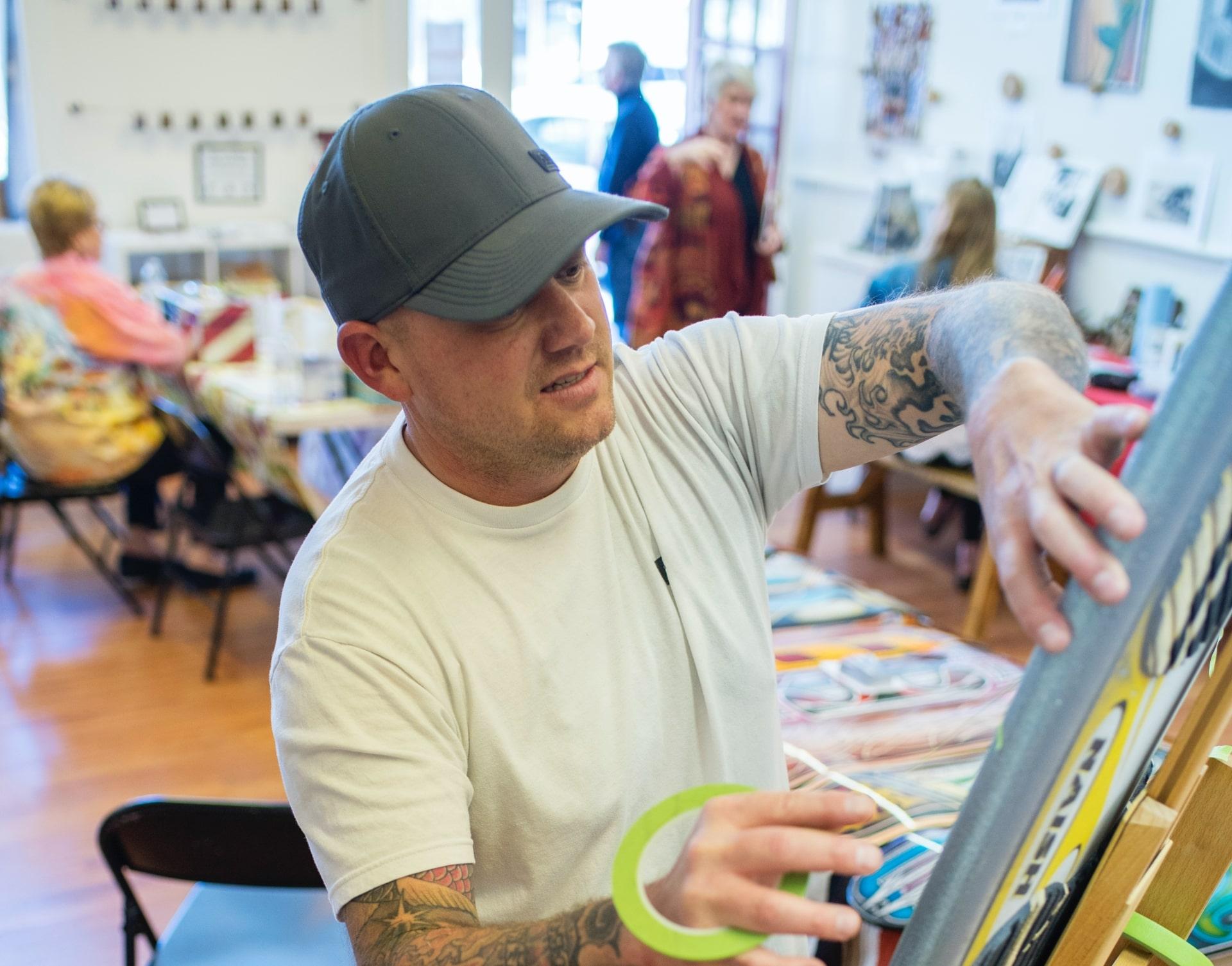 Artist Sylas Jumper working in art workshop